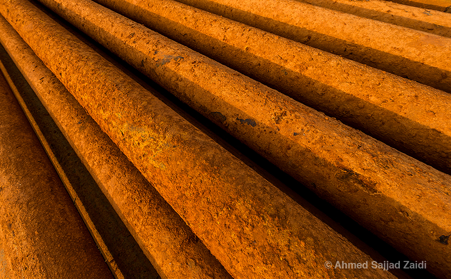 Golden light on rusty iron pipes