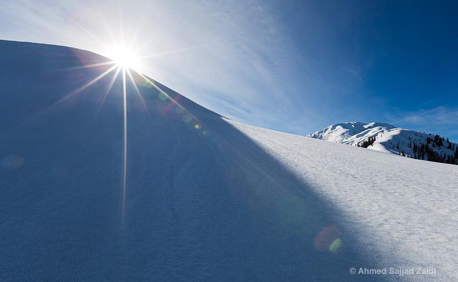 Lens flare snow Makra Peak